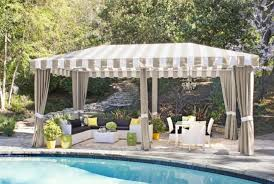 black and white striped l shade cabana poolside design with striped awning covers also woven outdoor