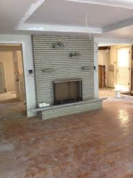 keep or resurface this fireplace surround in gutted midcentury raised ranch