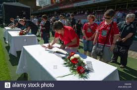 memorial service sign in book soccer fans sign the book of condolence during the memorial