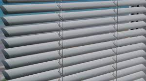 view from the open window with blinds on the sea in summer stock