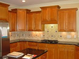 kitchen cabinets with backsplash brown wooden kitchen cabinet with black granite countertops