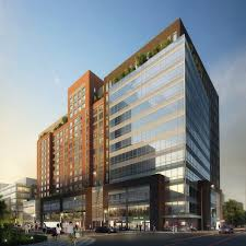 phase i buildings top out at flushing commons in queens new york