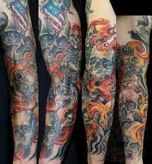 collection of 25 skull and flames tattoos on sleeve