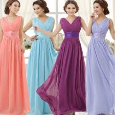 purple and yellow wedding bridesmaid dresses yellow flowers in