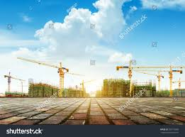 crane building construction site against blue stock photo