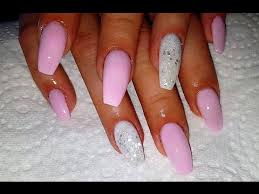 pink and white glitter nail design long coffin shaped acrylic