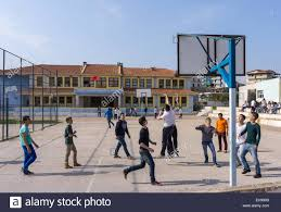 children playing basketball at a in ksamil in southern