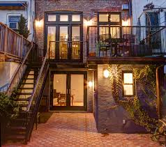 can you have a metal stair in a backyard from the 2nd floor to