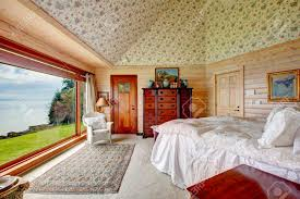 plank paneled bedroom with wallpaper cathedral ceiling