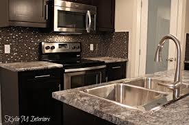 harold pionite laminate countertop with glass mosaic backsplash