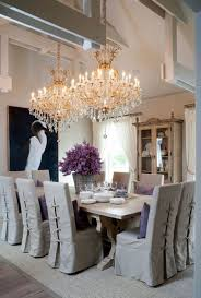Dining Room Crystal Chandeliers Cottage Style Dining Room Illuminated With Double Grand Crystal