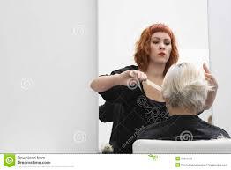 old ladies hair salon hair stylist cutting senior woman s hair stock image image of