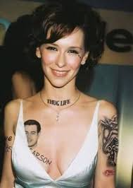 smiling women show men face and carson word tattoo make on chest