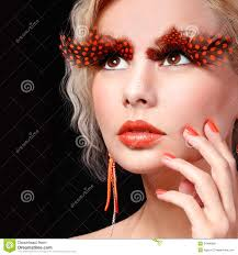 Fashion Halloween Makeup by Fashion Blonde Model With Long Orange Eyelashes Professional