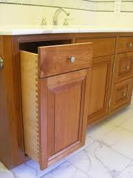 Bathroom Cabinet With Built In Laundry Hamper This Cherry Bath Vanity Features A Hamper On The Left Side Built
