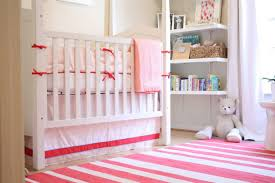bedroom tidy white wall bookshelves and white crib in small baby