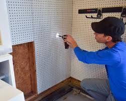 how to hang tools in shed how to install a pegboard how tos diy