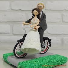 custom wedding cake topper decoration riding bike together
