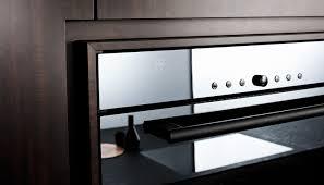 contemporary kitchen wooden stone island nero assoluto