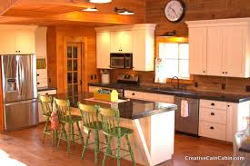 super modern white kitchen and dining space in a log cabin house