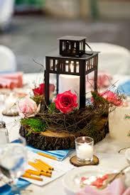 lantern centerpiece my wood slice lantern centerpieces weddingbee photo gallery