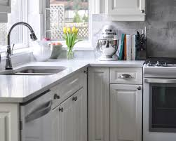white kitchen cabinets with glass cup pulls the finishings make all the difference cup pulls in the