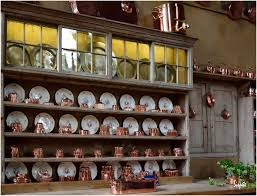 antique country style interior kitchen with copper molds antique