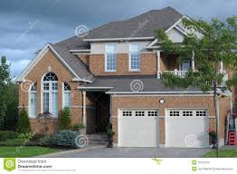 new house with a double garage stock photos image 10724373