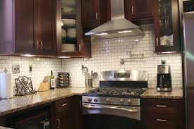 subway tile backsplash with dark cabinets home design ideas and