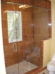 bathroom brown merola tile wall with wall sconces and kohler