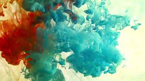 colorful paint in dynamic flow color jet of ink on white