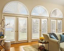 decorating chic sunburst shutters in white matched with wooden