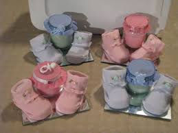 baby booties a candle and pacifier centerpiece for your baby