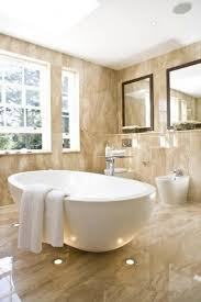 beige bathroom designs luxury bathroom in beige marble with a white bathtub with marble