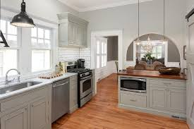 Gray Kitchen Peninsula With Butcher Block Countertop - White kitchen cabinets with butcher block countertops