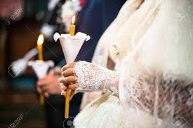 orthodox wedding candles wedding ceremony in orthodox church and groom holding