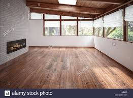 empty room with panoramic windows wooden floor and ceiling and