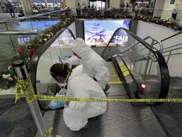 lt p gt Workers clean the escalators that lead to the baggage claim area at terminal Yahoo