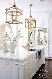 Pot Filler Kitchen Faucet Stunning White Transitional Kitchen With Brass Chandeliers