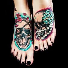 coloured skull on tattoos skin
