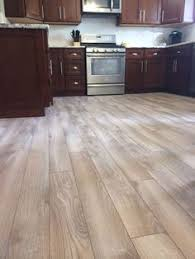 floors decor and more gray wood floors warm cherry cabinets white counters