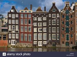 house facades damrak canal amsterdam the netherlands europe stock