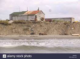 global houses eskimo houses close to sea edge following global warming induced