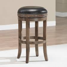 wooden bar stool with molded leather seat stock photo image