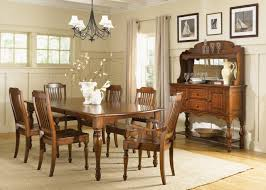 classic brown stained wooden dining table under black wrought iron