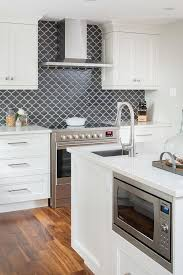 black backsplash in kitchen black appliances design ideas