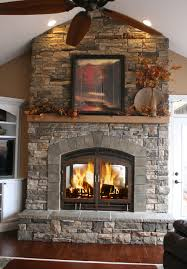 floor to ceiling stone fireplace with full width wood mantel