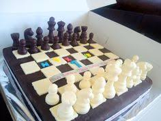 birthday baking chessboard cake with chocolate chess pieces