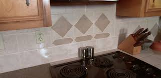 adding a tile or wood beadboard backsplash to your kitchen