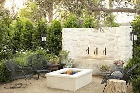 l shaped patio sofa with fire pit and turquoise stones